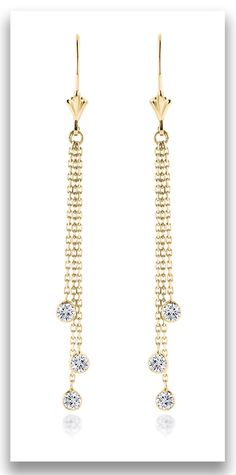 These exquisite Ladies Chandelier Earrings With Diamonds By The Yard showcase a classy design and are decorated with 0.6 carats of dazzling round diamonds, each masterfully handset in lustrous 14K gold
