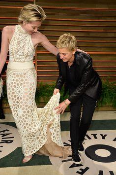 Ellen DeGeneres helped Portia de Rossi with her dress at the Vanity Fair Oscars party.