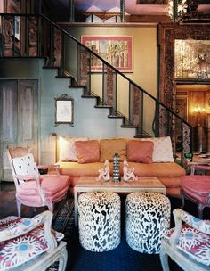 Pink eclectic living room that has a wood cabin vibe!