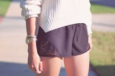 Emilee Anne in Los Angeles wearing a H sweater and Katwalk shorts.