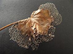 Evil skeleton leaf by Rawgash