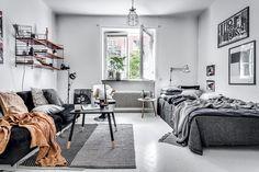 Grey studio apartment with orange accents