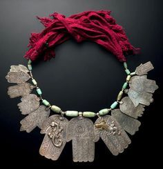 Moroccan Tafilalet Necklace with 13 silver khamsas, silver beads, amazonite beads, wool and cotton.