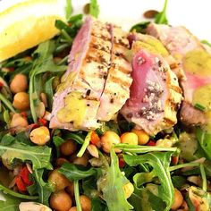 "Smokin'!! Seared Tuna Arugula Salad complete with all your macronutrients (proteins, carbs and fats) by @relauncher_alison! Don't forget about the power of ""legumes,"" and in this case, garbanzo beans, as a great source of carbohydrates and protein...."