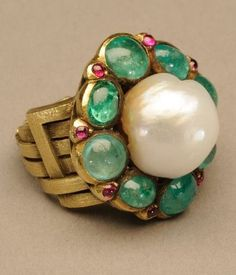An Arts and Crafts ring of gold, baroque pearl, emeralds, pink sapphires and possibly rubies, by Marie Zimmermann, circa 1922. #MarieZimmermann #ArtsAndCrafts #ring