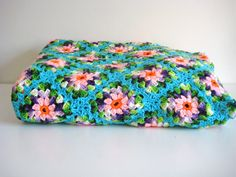 Absolutely gorgeous granny square blanket. Blue and Pink Vintage Afghan. $78.00, via Etsy.