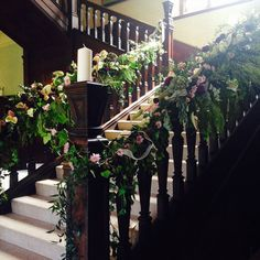 Our beautiful Staircase at Buckland Hall. Decorated by Queens Florist
