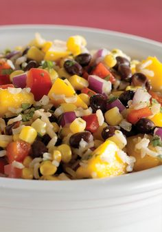 Black Bean and Mango Chicken Salad-  This savory blackbean, chicken and mango salad recipe is easy to prepare and perfect for your summer party.