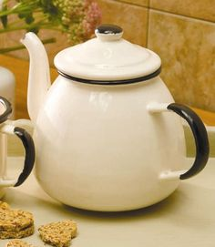 I just love the shape of this enamel teapot                                   ****