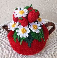 Olenas Tea cozies and Crafts are each individually make to order. No assembly line, no manufacturing process. Just a unique design, made like no other My model tea pot (I brought it from Ukraine) is for 3 cups. However I now make a tea cozy for every shape and size. For the base I use a special bulky Chenille Velvet yarn, which I order from the factory in Turkey. For flowers and leaves, I use only 100% cotton thread. To make them look more real, I use variegated colors. Most of this type…