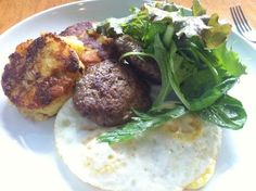 2 eggs over medium, potato cakes, elk sausage and salad | Yelp
