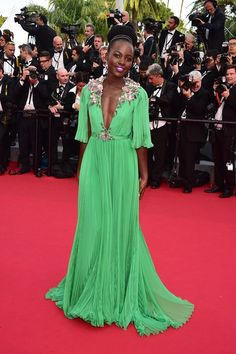 Lupita Nyong'o wearing a dress by Gucci and Chopard jewellery at the Cannes Film Festival 2015