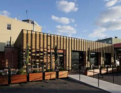 ODA architecture: breadbox cafe - facade made of baker's rolling pins