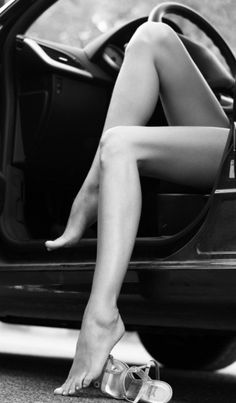 He was driving,  she takes off her clothes and get totally naked. She put her legs on His chest and... came to him. ..