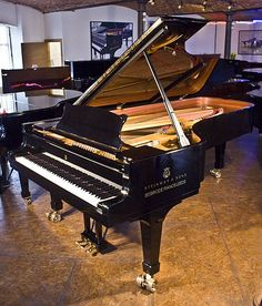 A Steinway Model D concert grand piano with a black case at Besbrode Pianos. This beautiful instrument is the preferred choice of the world's greatest pianists.