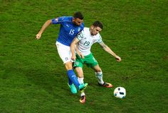 Robbie Brady of Republic of Ireland controls the ball under pressure of Andrea Barzagli of Italy during the UEFA EURO 2016 Group E match between Italy and Republic of Ireland at Stade Pierre-Mauroy on June 22, 2016 in Lille, France.