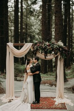 This super crafty couple DIYed nearly everything for their Berkley wedding, including that impressive wood, fabric, and floral ceremony arbor | Image by From the Daisies