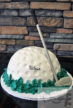 Check out this Grooms Cake!!! This a golf ball and club. The golf ball is made of cake.