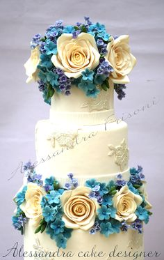 Blue teal and white wedding cake