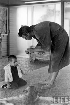 Steve McQueen with his son, Chad at home in 1963.
