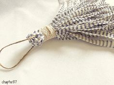 make a simple tassel for a curtain tie-back or a doorknob…