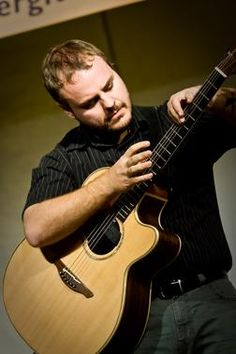 Andy McKee, an American Finger-Style Guitar Player, and one of my top ten musicians.