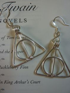 wire deathly hallows earrings | a few wires, could be DIY