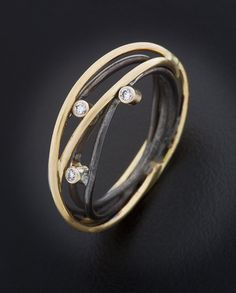 "Ring | Randi Chervitz. ""Wrapped"". Oxidized sterling silver, 18k gold, white diamonds."