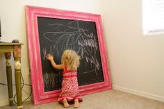 Paint a HUGE piece of wood with Chalkboard paint, then attach moulding around it.  Instant fun for the kiddos