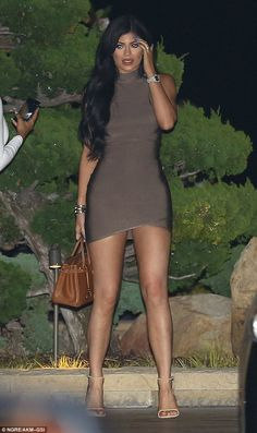 Kylie Jenner squeezes into a tight mini-dress for a meal with family at Nobu | Daily Mail Online