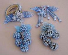 """early Hess unsigned pin made of baby blue glass beads and poured glass leaves, 3-5/8"""" by 3"""".http://www.morninggloryantiques.com"""