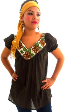 Love the beaded Mexican blouse paired with a vibrant head-scarf!