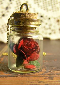 Love this! Beauty and the Beast rose necklace! $14.98 on etsy.