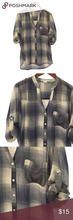 STARING AT STARS ROLLED SLEEVE BUTTON UP BLOUSE STARING AT STARS ROLLED SLEEVE BUTTON UP BLOUSE. PLAID PRINT. V- NECKLINE. POCKET. LONG SLEEVES. FABRIC: POLYESTER. CONDITION: LIKE NEW/ NO SIGNS OF WEAR. SIZE XS. Staring at Stars Tops Blouses