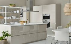 Modern IKEA kitchen ideas with light beige doors, drawers and worktops and coloured TUTEMO open cabinets.