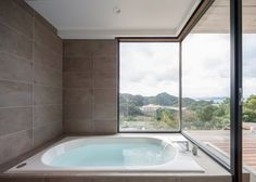 Weekend residence in Japan featuring a bath with mountain and coastline views