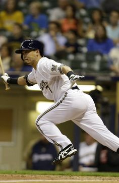Norichika Aoki #7 of the Milwaukee Brewers singles in the bottom of the ninth inning against the Cincinnati Reds during the game at Miller Park on August 15, 2013 in Milwaukee, Wisconsin. (Photo by Mike McGinnis/Getty Images)