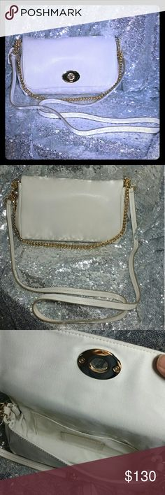 "Coach mini Ruby crsbdy ivory NWT Coach mini Ruby crsbdy ivory NWT.  Gold tone hardware. Flap top with golden turn lock. Lined interior with open slip pocket. Gold tone chain to convert to clutch, removable abd leather shoulder strap 20"" drop removable. 8"" L x 5"" H x 1"" W. New with tags. Coach Bags Crossbody Bags"