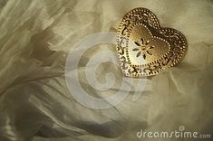 Heart of golden metal stock photo. Image of romantic - 137527142 Romantic, Stock Photos, Silk, Heart, Metal, Image, Metals, Romance Movies, Romantic Things