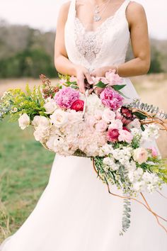 Unique bridal bouquet in a basket | Mint Photography | see more on: http://burnettsboards.com/2014/08/monets-water-lilies-wedding-inspiration-shoot/