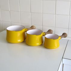 One big, bright, happy family! The trio of saucepans is from the Kobenstyle line by Jens Quistgaard for Dansk. They are absolutely stunning in a vivid