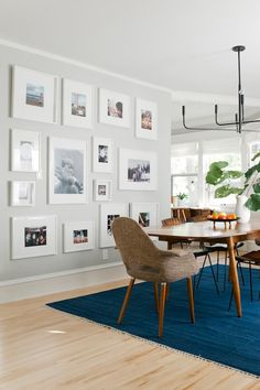 Sherwin Williams aloof gray PLUS IKEA hacked white photo wall....  Similar floor and dining table colors. Likely less light.