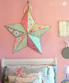 Decoupaged star, nice way to freshen up tired themed decor.