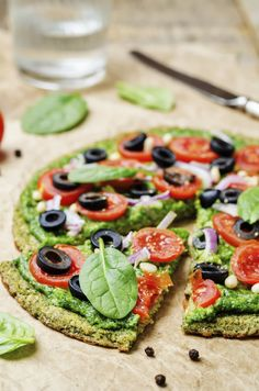 Delicious gluten-free quinoa pizza crust topped with our homemade non-dairy creamy pesto sauce, just add in your favorite veggies!