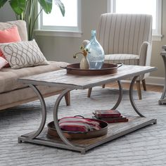 Belham Living Edison Reclaimed Wood Coffee Table - Bring home industrial glamour and a place for your coffee mug with the Belham Living Edison Reclaimed Wood Coffee Table. This on-trend coffee table in...