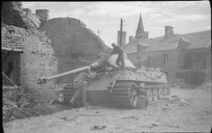 Troops inspect a knocked out King Tiger tank in Plessis-Grimoult, 10  August 1944.