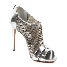 Make a daring fashion statement with these metallic silver heels from Casadei. Made from quality leather in Italy, these heels feature an attractive chain-link look across the middle of the shoe and a