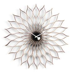 Nelson Sunflower Clock, designed by George Nelson.The Nelson clocks were first born from a festive evening of collaboration. George Nelson recalls: 'And ther George Nelson, Vitra Design Museum, 1950s Design, Quartz Clock Movements, Toilet Paper Roll Crafts, Toilet Paper Rolls, Wall Clock Design, Messing, Home Accessories