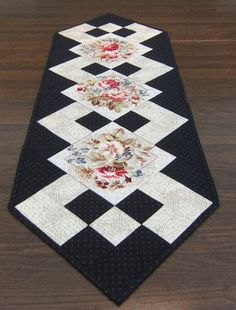 "Black and White Table Runner with Flowers by QuiltingGranny [   ""Black and White Table Runner with Flowers 13 x 41 inches This elegant table runner will bring beauty to your dining decor. Three squares with"" ] #  # #Subdued #Polka,  # #Quiltig #Ideas,  # #Cream #Fabric,  # #Black #Fabric,  # #Runner #Patterns,  # #Quilted #Table #Runners #Patterns #Free,  # #Three #Squares,  # #Table #Noir,  # #Decor #Three"