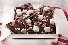 Celebrate the holidays with this Marshmallow and Peppermint Bark Recipe. This Marshmallow and Peppermint Bark Recipe made with marshmallows and crushed peppermint candies can be a delicious, festive gift.